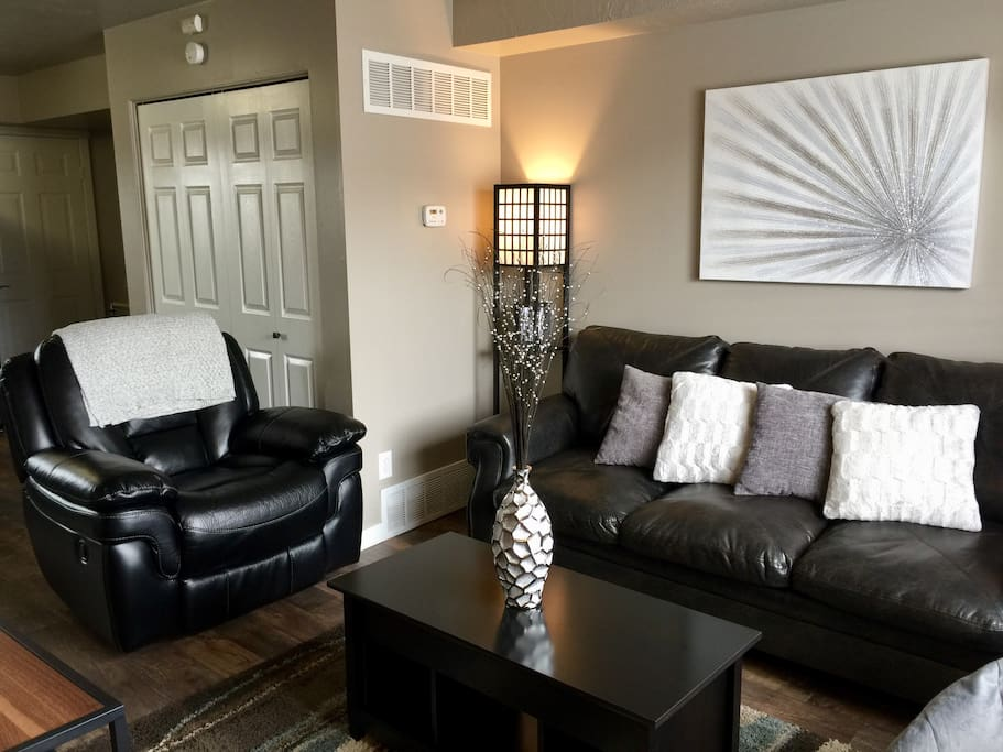 Relax in the living area on the large couch and reclining/rocking chair.