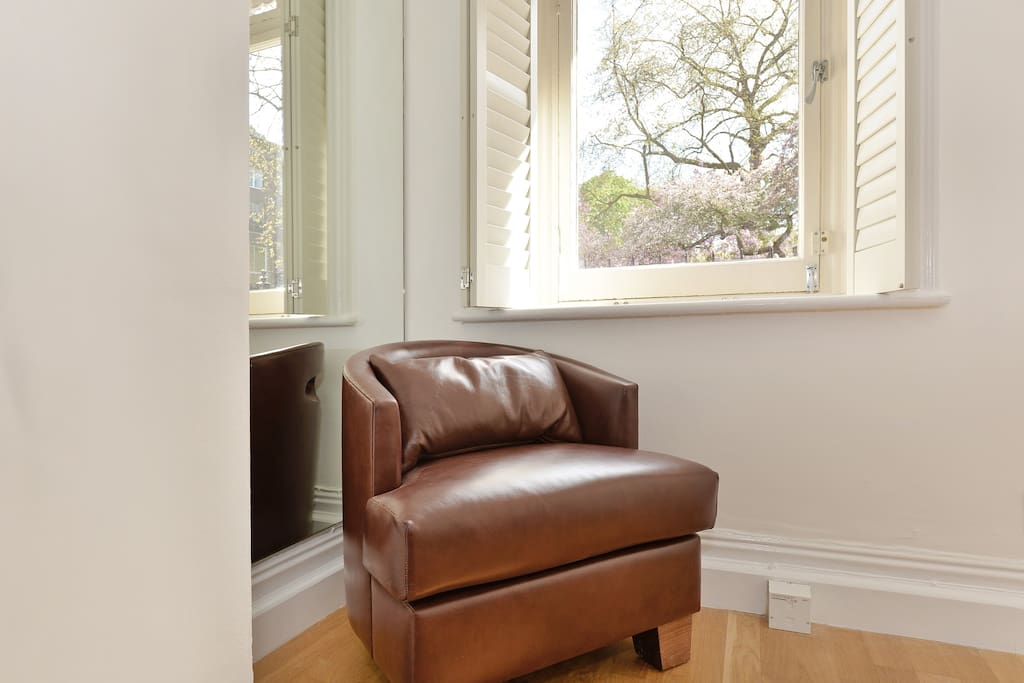 The very comfortable mock leather armchair