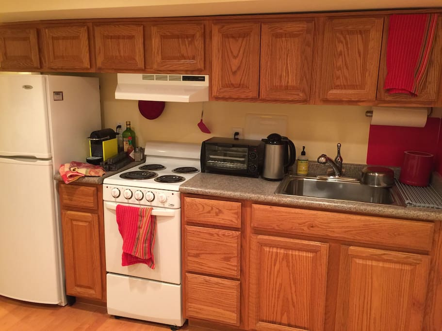 Your fully functioning stocked personal eat-in kitchen. Basic condiments (salt, pepper, olive oil), pots, pans, dish ware, silverware, hot water pot, and full refrigerator provided in apartment. Toaster oven, clothing iron and coffee machine stored, but available, in adjacent laundry room if desired to augment your Base Camp experience.