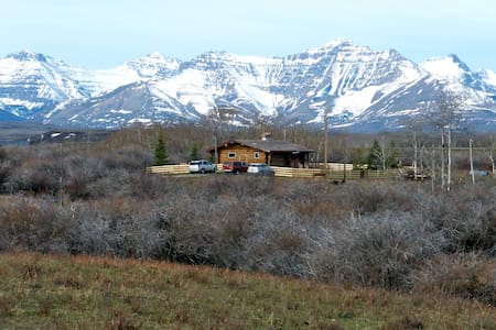 A log cabin in the woods - Twin Butte