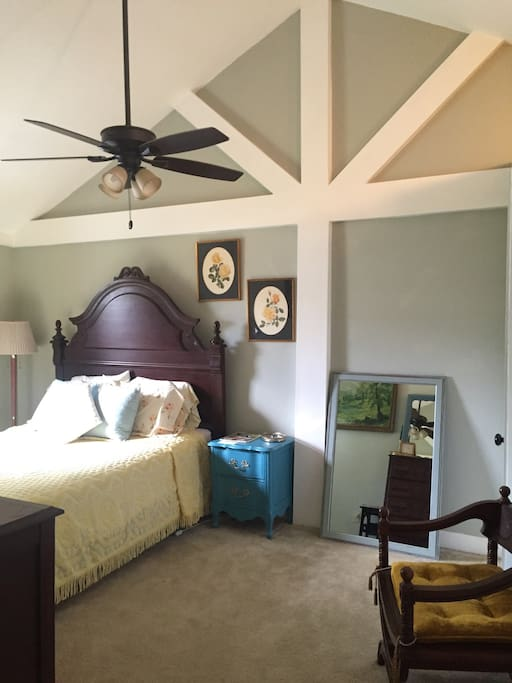 Vaulted ceilings make this spacious room even better. Lots of natural light if you like but you can almost black-out the window also if you prefer. Ceiling fan can be used with/without lights. Bedside lamp for nighttime reading.