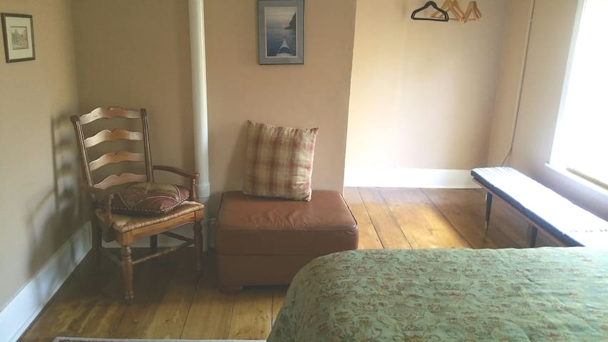 Wide board floors, two windows, air conditioner, closet