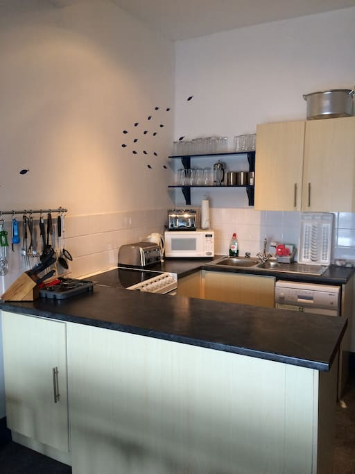 Fully equipped kitchen. Cooker, kettle, microwave, toaster, dishwasher and fridge.