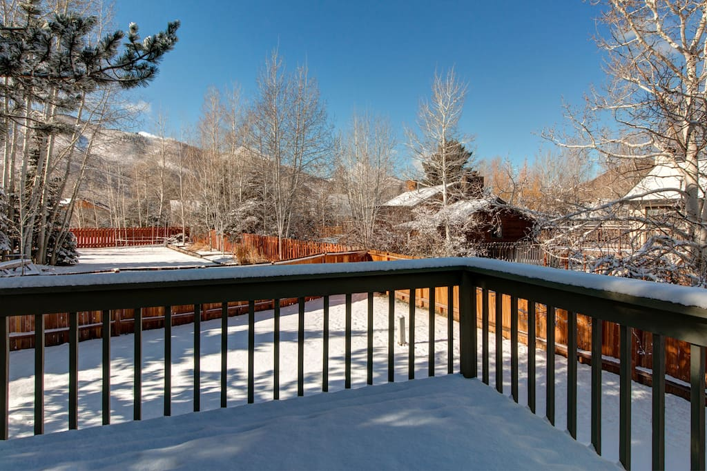 Enjoy gorgeous views on snowy days from the upstairs balcony.