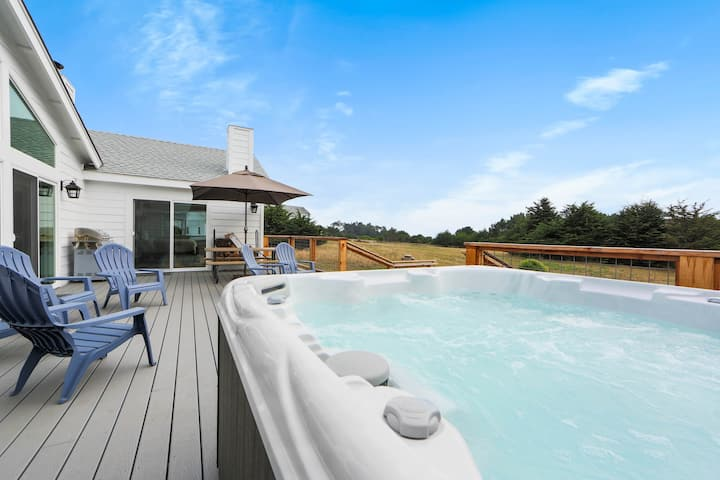 Beautiful ocean view home w/ hot tub, deck, fireplaces & fire pit - 2 dogs OK!