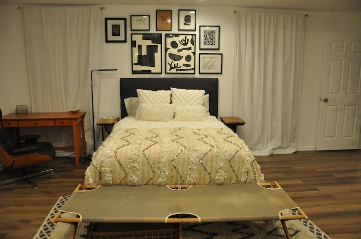 Master Bedroom with Queen bed and two work desks.