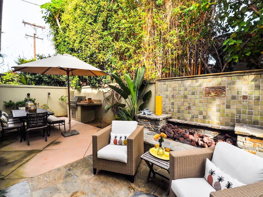 Private and lush back yard with full size grill, plenty of seating and 6 person hot tub