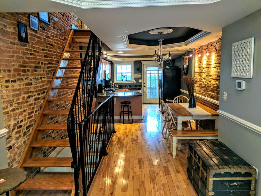 As you walk into the home you'll be met with a luxurious view of our rowhome leading back towards the kitchen and outdoor patio. You'll love the exposed brick throughout the home.