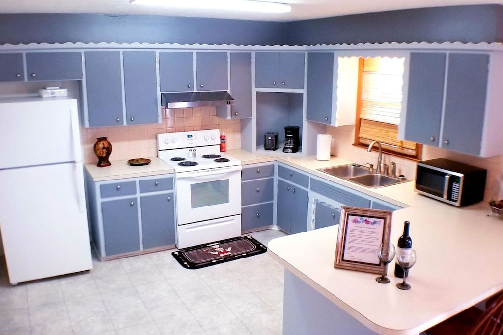 Large kitchen with everything you need to prepare a scrumptious meal including pots, pans, plates, utensils, coffee maker(with coffee, creamer, sugar) microwave, toaster and many other features to make your stay just like home.