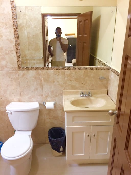 New bathroom, marble floors and walls.