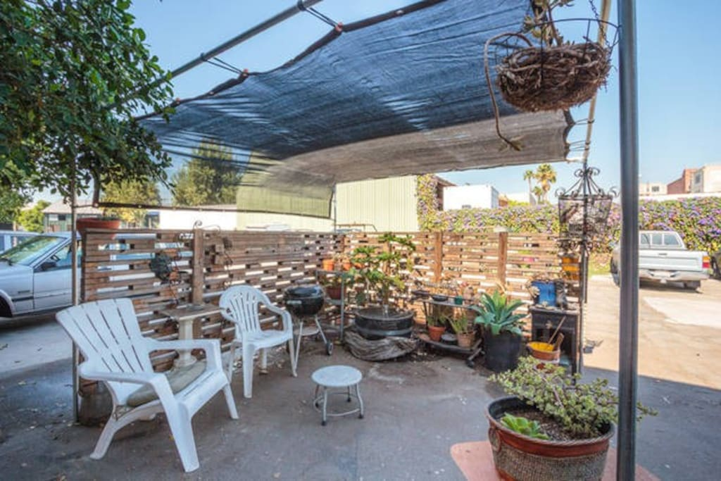 patio garden, with shade & bbq grill.