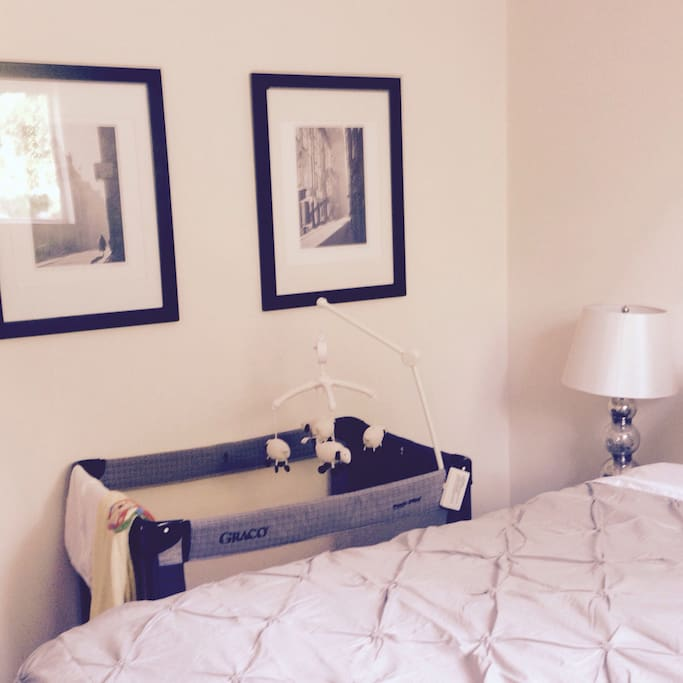 One of the bedrooms with a queen bed. A pack and play is available for use.