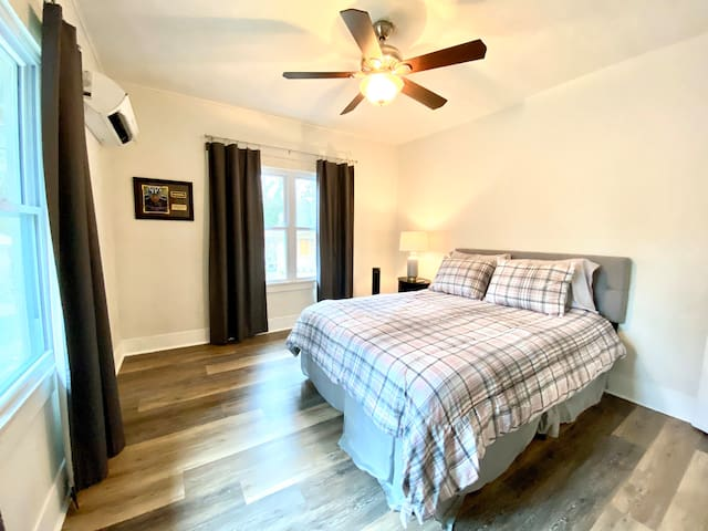 Each bedroom comes furnished with a comfortable queen-sized bed, nightstand, bedside lamp with USB outlet, a remote controlled mini-split A/C & heating unit, a tower fan and ceiling fan.