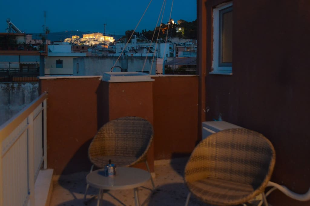 Have your dinner in the veranda under the crystal clear Athenian sky