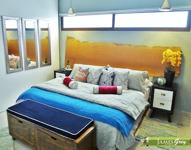 Comfortable king size bed with high quality mattress and blackout blinds to ensure a good night's sleep