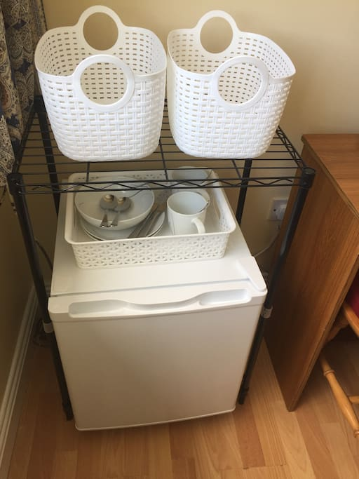 Mini fridge in room.