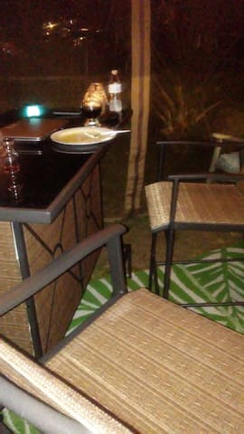 Outside Bar/Gazebo area with mini fridge -- fits about 3 - 4 ppl comfortably.