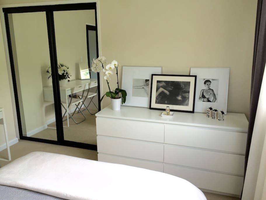 Double mirror sliding doors for a super spacious closet. Hangers provided.
