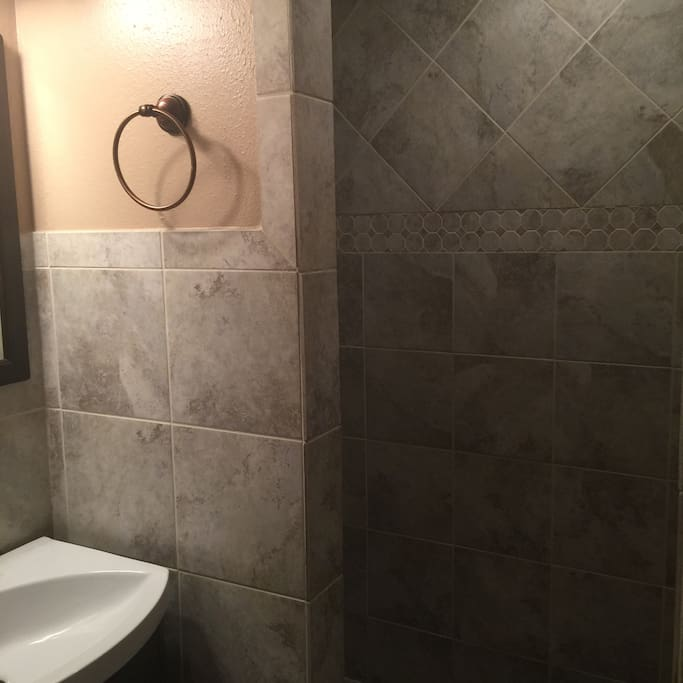 Shower in bathroom connected to guest bedroom #1