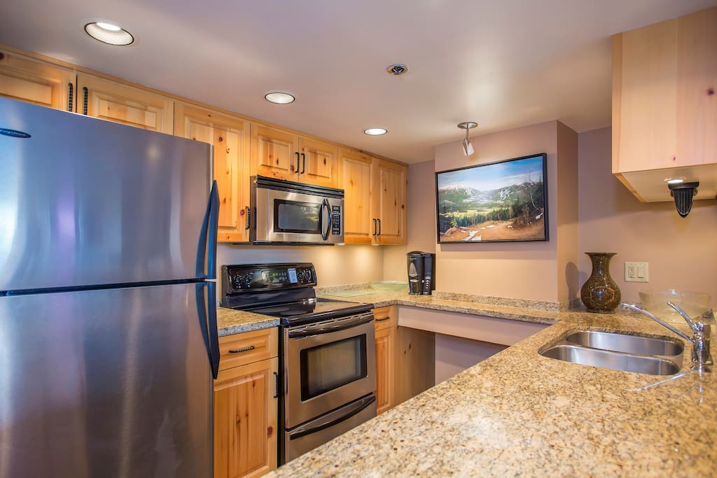 The kitchen is fully-equipped, features granite countertops, and has an open-layout so you can still chat with company in the living room.