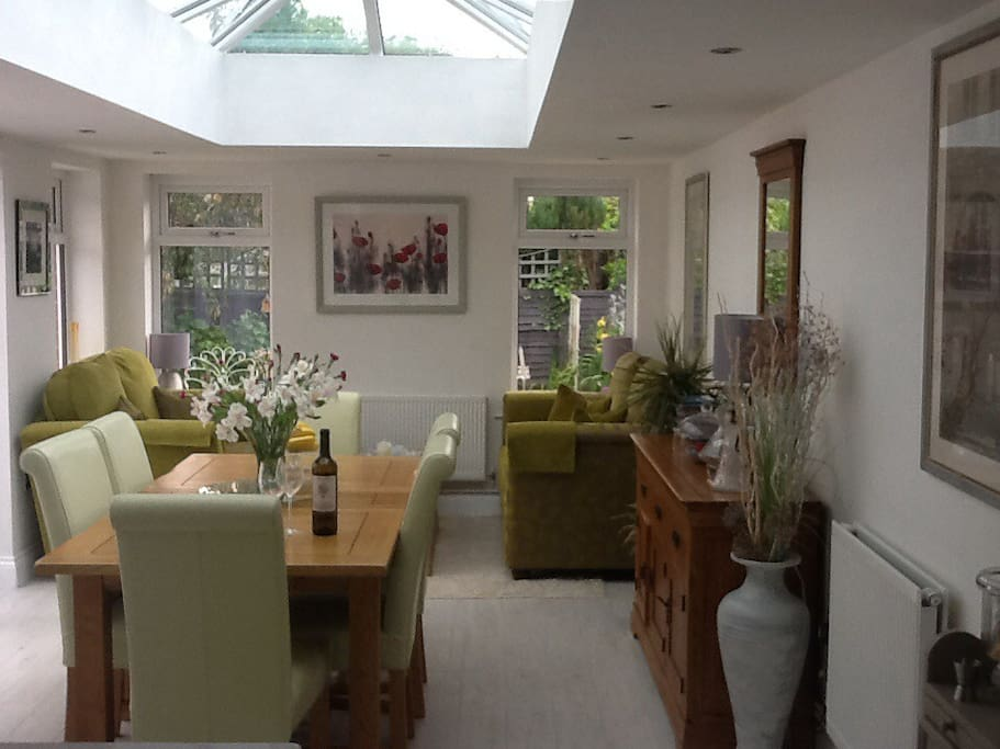 Dining family room with comfortable seating area and garden views.