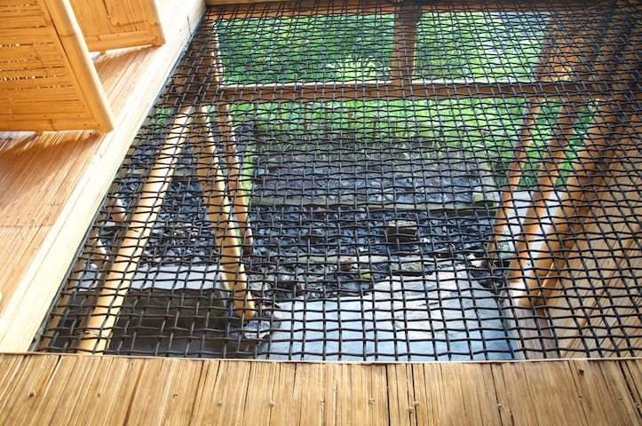 Bringing a piece of garden into the  Panorama Room. The net is a tranparent  elements to create visual connection between spaces. It is also functional.  Maximum 2 persons at one time, please!