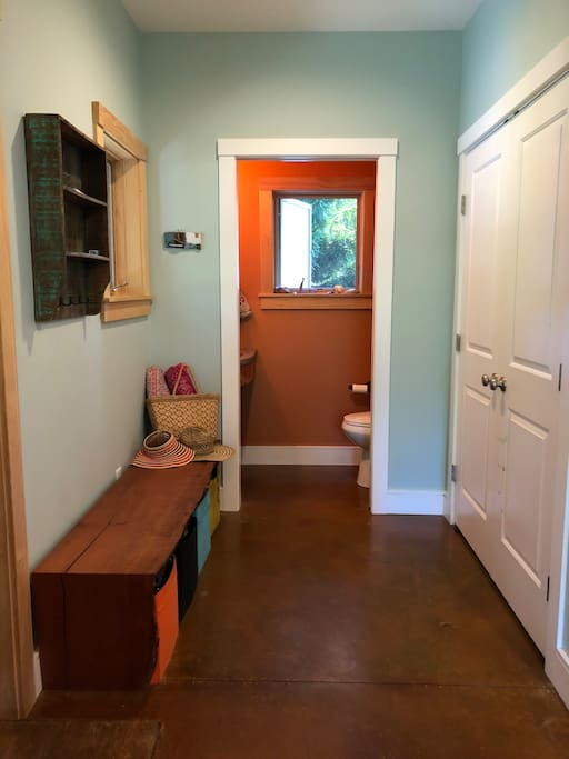 Just upon entry you'll find a closet and bench for your items, and a half bath.