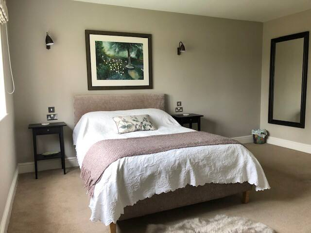 The newly refurbished ground floor bedroom has a lovely comfortable double bed, new mattress and topper, plenty of towels and original artwork on the walls! The room also has underfloor heating, built in wardrobes, WIFI, TV and DVD player!