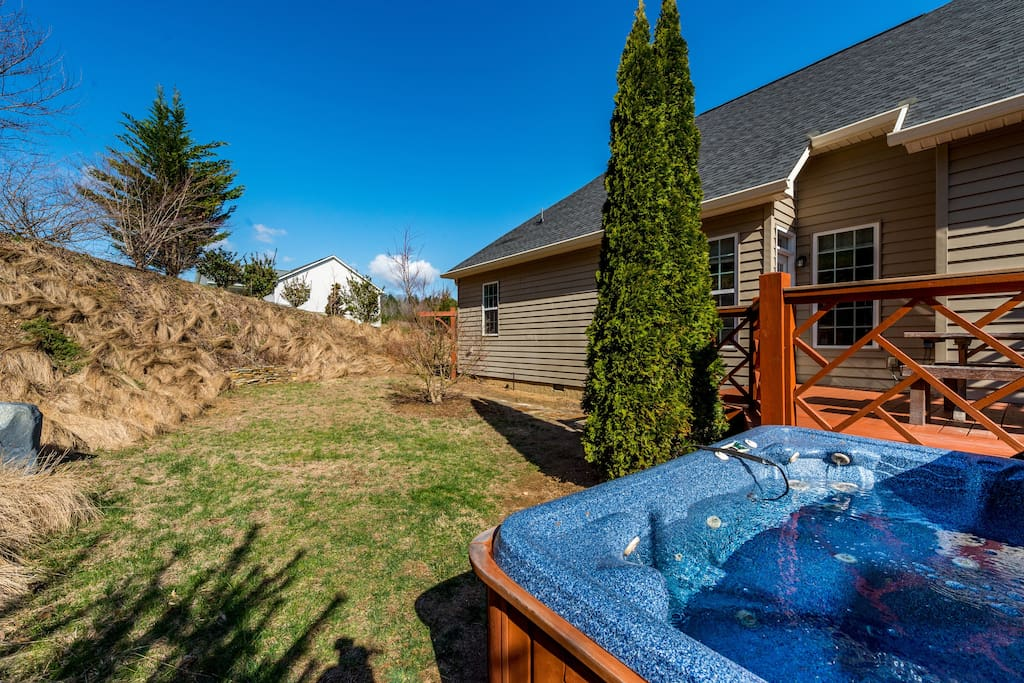 Take a soak in the private hot tub with views of the 1-acre property.