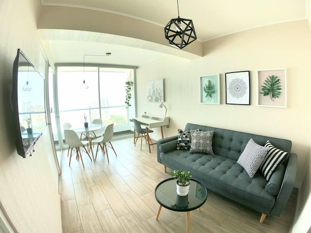 Oceanview living room with Nordic design includes sofa bed, dining table, study desk, TV and balcony