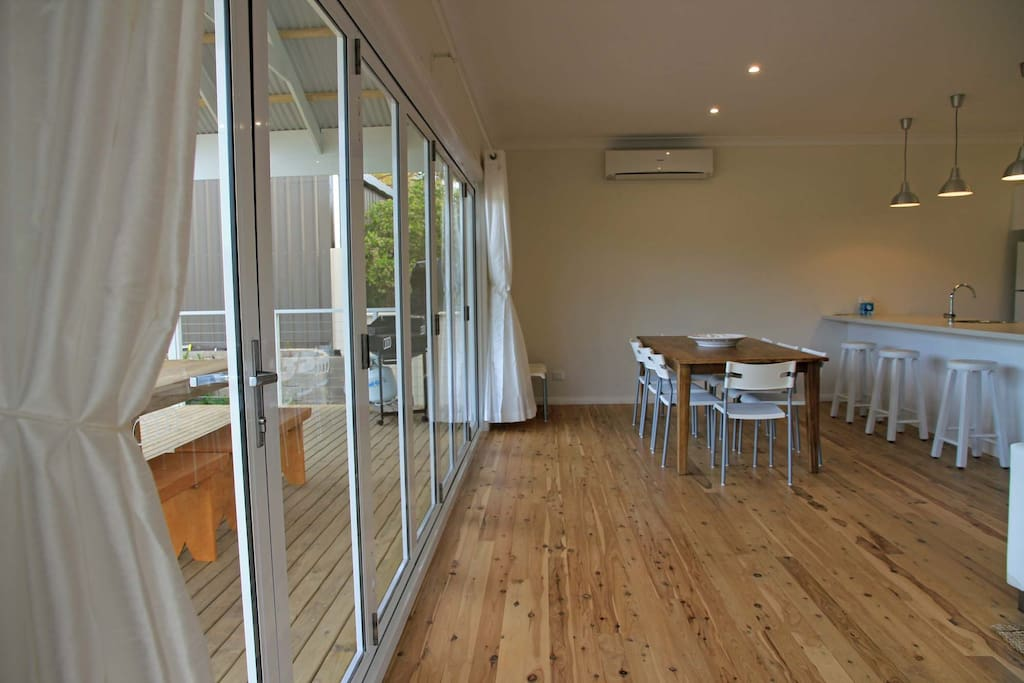Large dining area with concertina glass doors to bring the outside in.