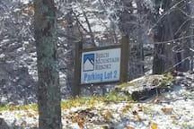 walk across the footbridge to access Beech Mountain Ski resort parking lot.