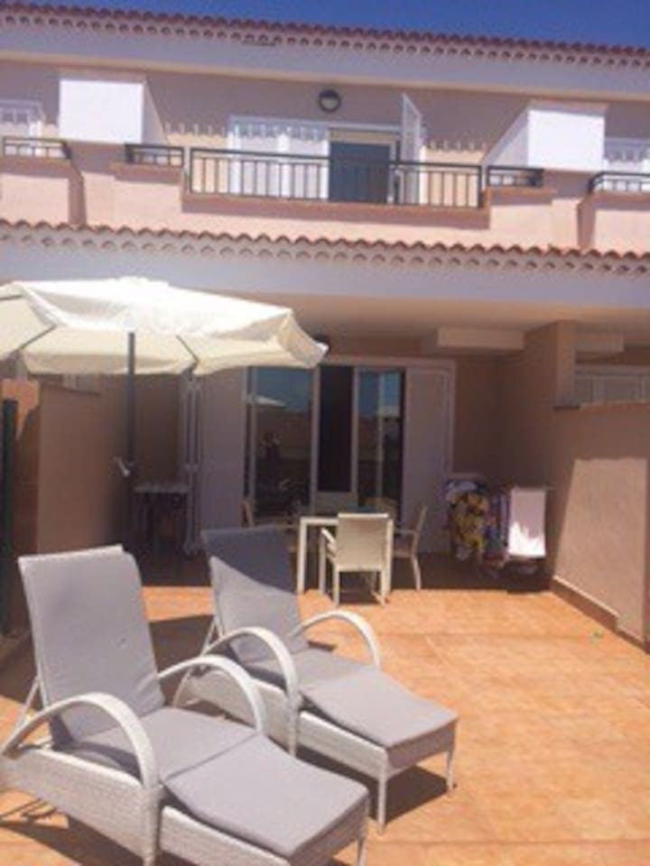 Ground terrace and balcony. Comfortable sun loungers and dining furniture. BBQ. Awnings now fitted.