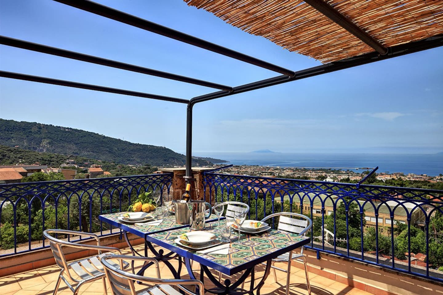 Your large private terrace, with a table and chairs, deckchairs and amazing panoramic views of the Gulf of Sorrento