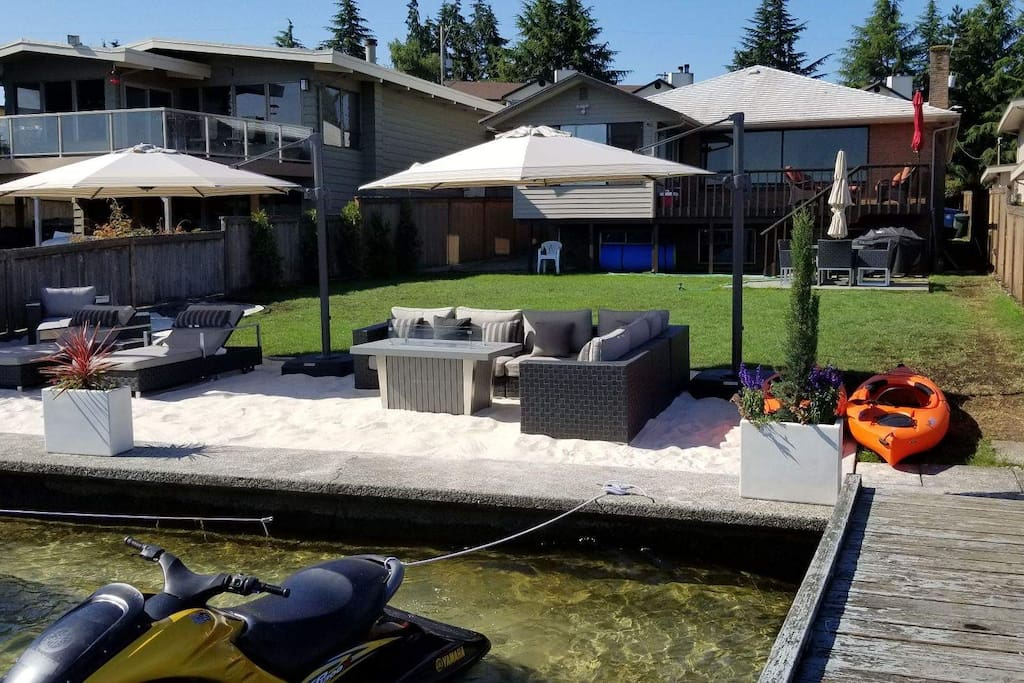 Sandy backyard patio with stunning views of Lake Washington.