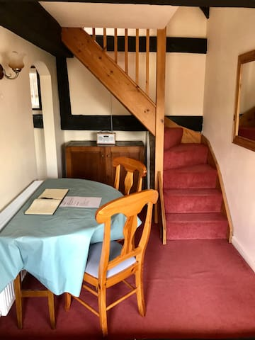 Dining table and stairs up to bedrooms