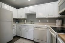 A kitchen to prepare meals for a family of four, equipped with a Keurig.