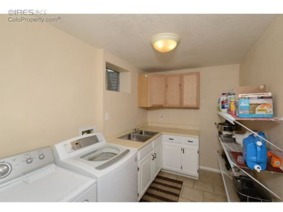 Laundry room in basement; with microwave.