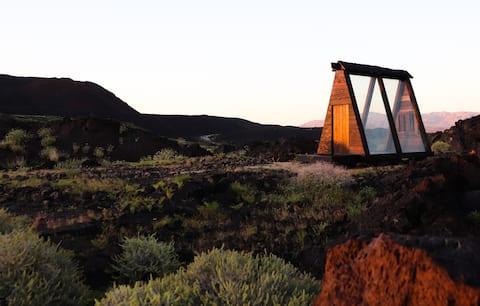 Volcanic Off-Grid Log Cabin!