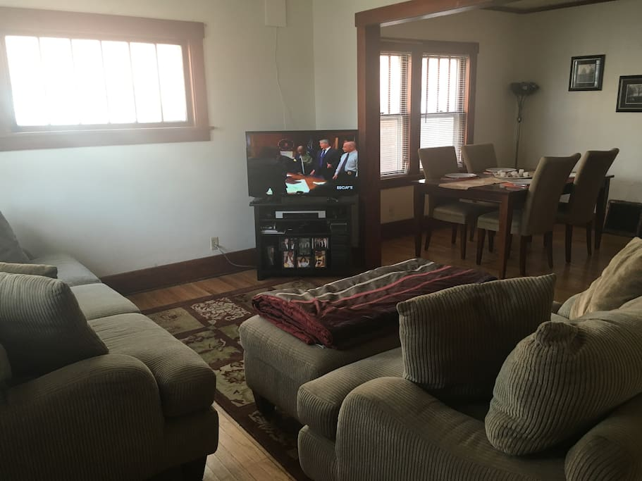 Living room & dining room area with TV & VCR.