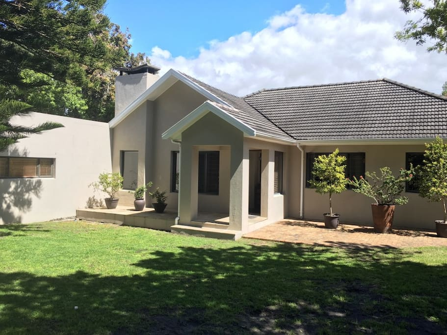 Front of house with large, enclosed garden.