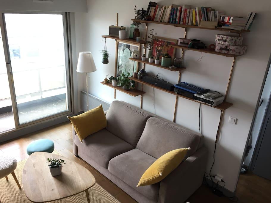 Our homemade shelf and comfy sofa bed