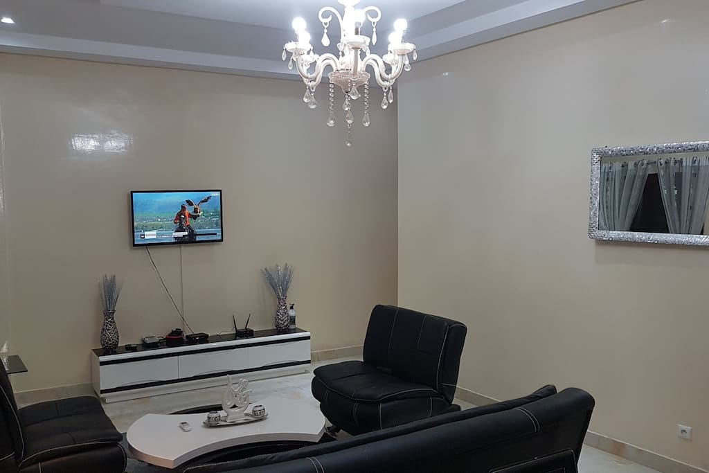 Large air-conditioned living room with luxury furniture and marble flooring