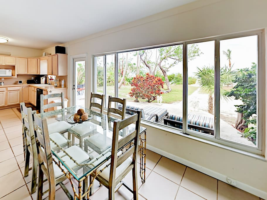 Wall-to-wall windows provide incredible sunset views in the formal dining area.