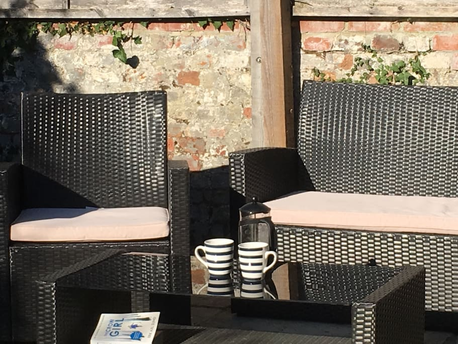 Sunny coffee spot in the secure back garden