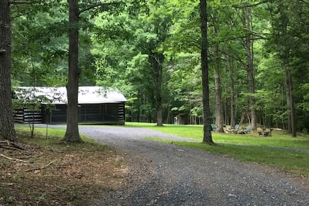 Secluded log cabin located in a beautiful setting.