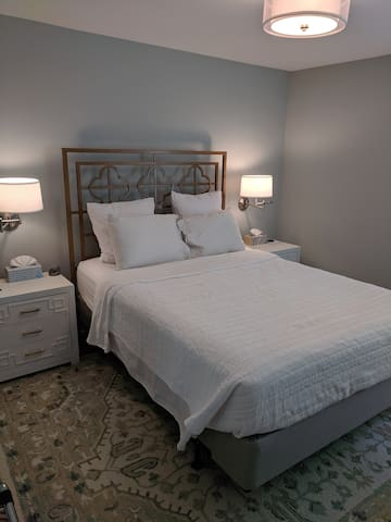 Queen bed and side tables.