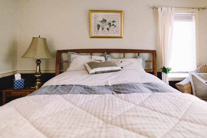 Comfortable queen-sized bed with down filled comforter