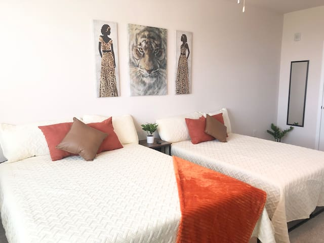 Bright and colorful bedroom with a queen and full bed