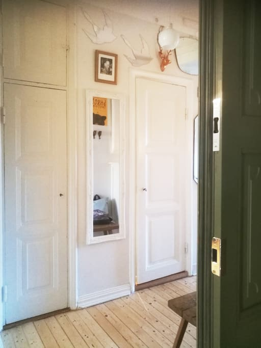 This is the view when you enter the flat. The front door is old and green and hallway filled with mirrors and art. It welcomes you with the old feel and peacefullness.